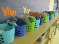 "Kindergarten workshop teacher Adrienne German uses these collapsable beach totes as student ""book bags."""
