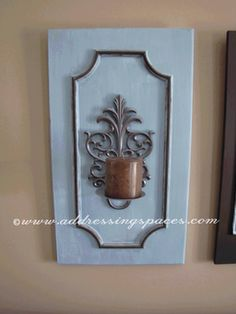 cabinet door made into diy walls sconce. I want to do this with some existing wrought iron sconces.