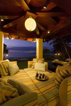 Timeless and Peaceful Interior Design Hawaii.  Outdoor beach house seating area.
