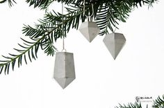 Minimal modern concrete diamond as well as concrete crystal ornaments. The silver colored loop makes it easy to attach them to whatever takes your fancy.