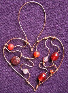 Red Heart - a beaded suncatcher glass beads: http://www.ecrafty.com/c-2-glass-beads.aspx