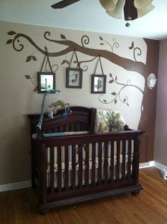 Really like the tree on the wall w/ picture frames hanging down....good idea