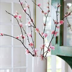 Blooms are made of tissue paper fashioned into flowers and hot glued to the branches