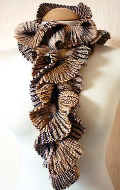 Helix Scarf by Stephenie Gaustad  Made several of these...fun fun fun to make.......This Pattern is good for almost every kind of yarn....It really shows you all if them I believe there is 24 different fibers