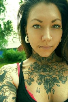 she is gorgeous and i love her tattoos