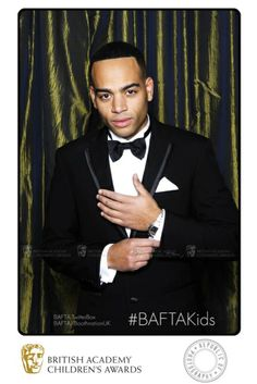 Rapper & comedian Doc Brown looking suave in the BAFTA TwitterBox backstage at the British Academy Children's Awards