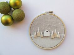 The North Forest - tiny wooden houses on linen hoop art