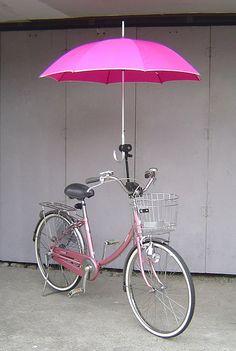 Pink bike....with umbrella. Always be prepared!