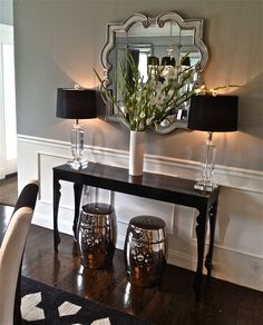 This is my selected hallway color and I NEED a table like this for my livingroom. Benjamin Moore Coventry Gray walls, black furniture with silver & white accents