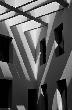 Interesting linear architectural light and shadow in building courtyard.  Raven van Baak