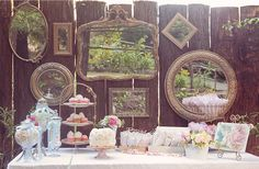 This is indescribably amazing.  I want to do this for a baby shower.  The combination of the vintage mirrors with the rustic wood fence is incredible!