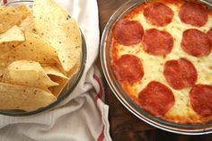 Pizza dip 1 (8 oz.) cream cheese; 1 jar (10 oz.) pizza sauce; 1 bag mozzarella cheese; Pepperoni (i prefer mini since it will be ate w/chips or crackers); layer in pie dish starting w/c cheese bake 400 degrees for 15 min until bubbly... I like to broil the top to get it a bit browner. Also, corn chips (scoops) are amazing with this dip!