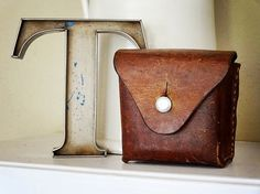 vintage leather ammo pouch likely Swiss or German – available at AtticAntics