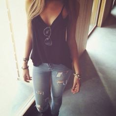 ripped light skinny jeans, black v-neck tank top with sunglasses and gold accessories. simple yet cute