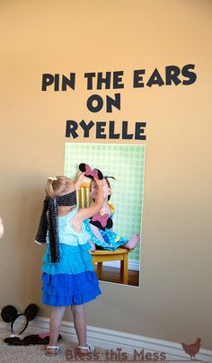 Minnie Mouse Birthday Party - game! too cute, pin the Minnie ears on the birthday girl's picture