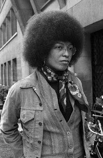 1975, Paris--Angela Davis, American political activist, scholar, and author. Davis emerged as a nationally prominent activist in the 1960s, when she was associated with the Communist Party USA, the Civil Rights Movement and the Black Panther Party.