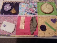 memory fidget quilts for alzheimer , autism , dementia, brain  trauma patients and restless fingers.Also known as Sensory Blankets
