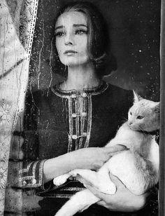 Audrey Hepburn. Sadness. On a raining day. Through the lens of Richard Avedon.