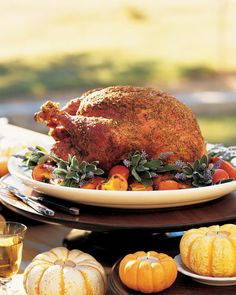 Salt-and-Pepper Grilled Turkey - A jumbo turkey is rubbed with generous amounts of salt and pepper and is slowly grilled over hot coals. A kettle grill works well for this recipe because the domed lid perfectly accommodates the shape of the turkey.