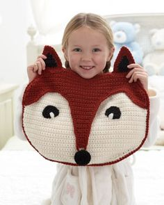 Free crochet pattern - fox, made with a special flap for stashing pajamas. Shown in Bernat Super Value.