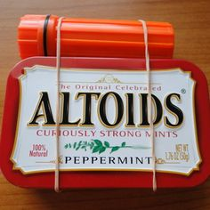 Altoids Pocket Survival Kit - filled with band aids, matches, etc. and strapped to a flashlight. Clever!