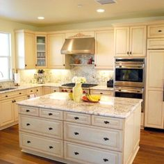 Antique white cabinets with light colored granite