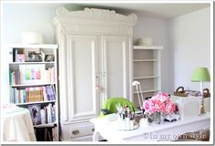 love the armoire with two simple ikea bookshelves on each side