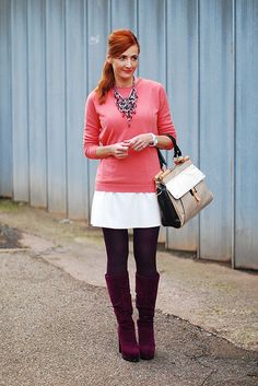 Coral sweater, statement necklace, white mini skirt & plum boots