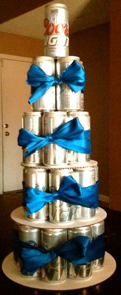 Beer Can Cake-Made Aug 2012.  Making it is easy. Just take 3 cake rounds (12″, 10″ & 8″), one 30-pack of beer and stack them! Take some 1″ ribbon and tape it around the beer can to complete the look. You can always add candles or ribbons at the top if you are using it for a birthday or anniversary!!