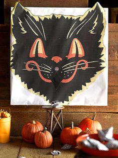 Enlarge vintage clip art to make a backdrop for this fun beanbag toss game. More ideas for a carnival-themed Halloween party: http://www.bhg.com/halloween/parties/kids-carnival-party-for-halloween/?socsrc=bhgpin092712beanbagtoss#page=12 vintage halloween, party games, vintage clip art, halloween parties, beanbag game, beanbag toss, fall carnival, bean bags, fall festival games