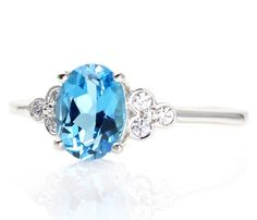 Swiss Blue Topaz Ring Diamond 3 Stone Ring December Birthstone Ring 14K White Yellow or Rose Gold. $589.00, via Etsy.
