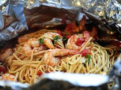 Pioneer Woman Shrimp Pasta in Foil in oven:  1/2 cup Olive Oil  4 cloves Garlic, Minced  3 whole 14.5 Ounce Cans Diced (or Whole) Tomatoes  1/2 cup White Wine  2 pounds Jumbo Or Large Shrimp, Peeled And Deveined  Salt And Pepper, to taste  Fresh Parsley, Minced  1 pound Linguine, Uncooked  Red Pepper Flakes, to taste