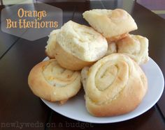 Orange Butterhorn recipe: one of the best orange roll recipes out there! NewlywedsOnABudget.net