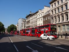 Images of London. Red buses are everywhere.