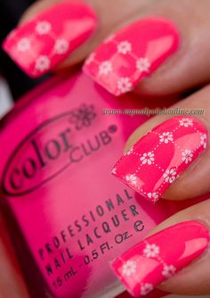 Color Club Poptastic with water decals http://www.mynailpolishonline.com/2013/01/color-club/daisies-on-neon/