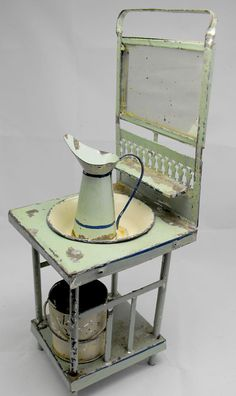 Vintage washbasin set tin toy from the 1900s