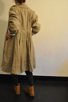 gathered back coat and ankle boots.