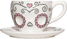 SUGAR SKULL TEA CUP Have a lovely cuppa tea any time of day! This set includes one sugar skull tea cup with darling day of the dead inspired designs along with a dainty dish for your tea cup to sit upon. $13.00