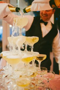 champagne tower! photo by Dixie Pixel Photography http://ruffledblog.com/virginia-boathouse-wedding #weddingideas #drinks