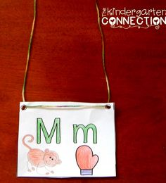 Alphabet beginning sound necklace! Kids love to wear them to show their learning! You can grab this Mm necklace free, along with nearly 20 more activities for learning Mm, free!