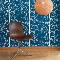 Hygge and West wallpaper, this bold white silhouette pattern will really make your room pop!