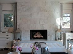 beautiful fireplace; love the accessories and accent furniture
