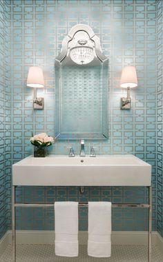 Powder room with modern geometric wallpaper. Designed by Martha O'Hara Interiors.