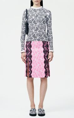 Neon pink floral print skirt with lace trim by Christopher Kane