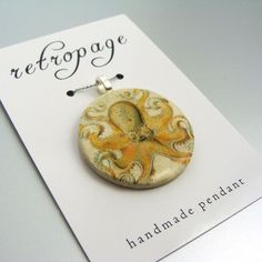 Take a page from our stylebook with this unique pendant from retropage. This eight-armed wonder was crafted from a vintage image and handmade into a precious pendant using the decoupage technique.
