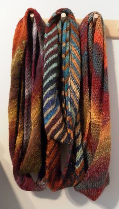 Ronbiais Loop. Knit on the bias in stockinette. Designer notes that the bias construction keeps the rolling down. Looks terrific worked in Noro yarn. Free pattern.  love - love - love this yarn!