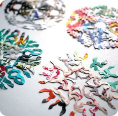 make colorful snowflakes from advertisements. yes!