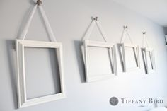 This is what I want above our bed. Tutorial for mounting knobs in a wall and hanging frames.