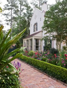 Boxwood (?) hedge with liriope underneath.  Garden with 'Old South' Style - Traditional Home®