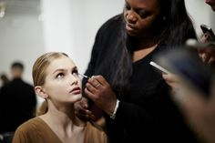 Pat McGrath backstage at the Women's Spring/Summer 2015 Runway Show, with the new Gucci Beauty Collection.